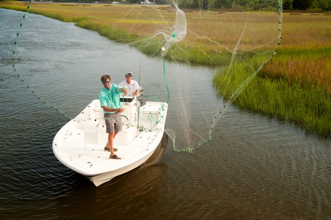 boating lifestyle, throwing a cast net.